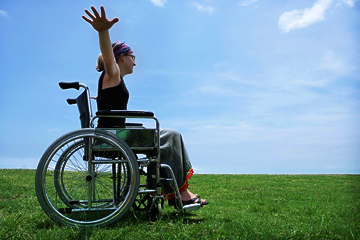 happy young woman in wheelchair