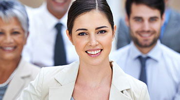 Picture of a businesswoman standing in front of a group