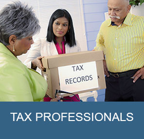 Tax professional hands tax records to a couple.