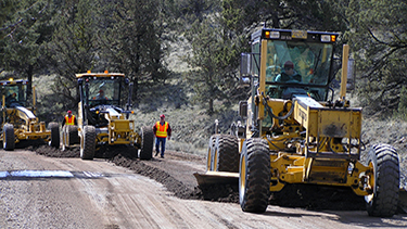 Graders working to smooth a road