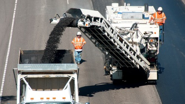 ODOT crew members remove old pavement from the roadway