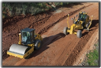 Construction equipment with GPS locators to guide vehicle paths