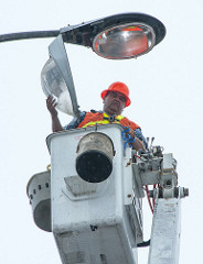 Maintenance work includes tending to overhead lighting
