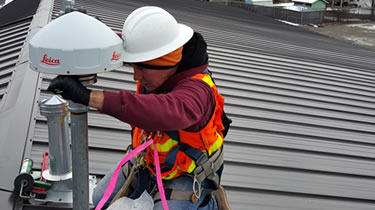 Employee installing a corrector station
