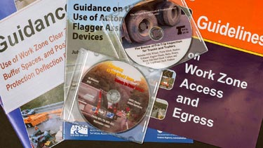 Assorted training pamphlets and CDs