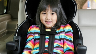 Child in a booster seat