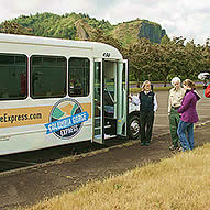 Woman and man talking outside before boarding the Columbia Gorge Express bus.