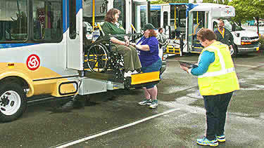 Person in wheelchair exiting bus