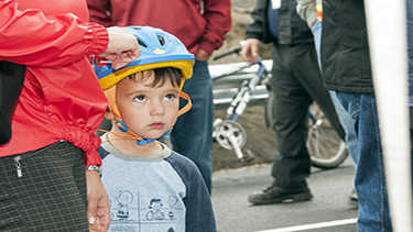 Photo of a child wearing a bike helmet at a safety event