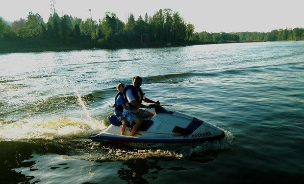 Father and sun on a jet ski.