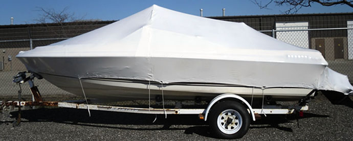 Image of a boat with a shrink wrap cover to protect the motor and wiring during cold winter months