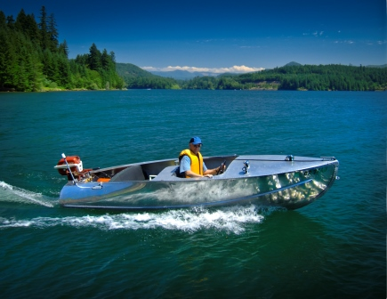 Don Nyberg enjoys a sunny day at Foster Reservoir in a  1950 Feathercraft aluminum boat and 1956 Johnson outboard motor