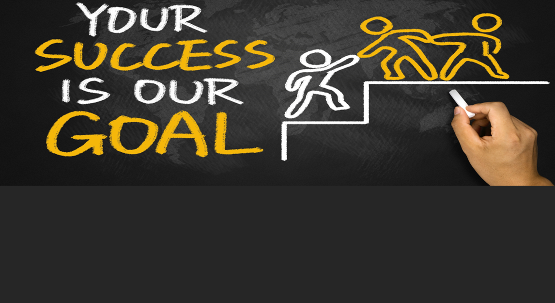 Picture of a hand writing Your Success is Our Goal on a chalkboard