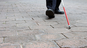 Person walking with cane