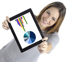 Woman holding tablet displaying graph