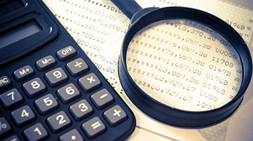 calculator, calendar and magnifying glass