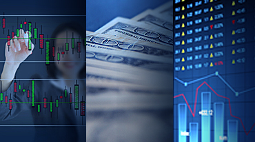 Asian woman writing on a graph; one hundred dollar bills; stock exchange reader board