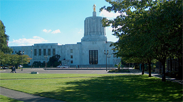 Oregon state Capitol, blue sky and trees