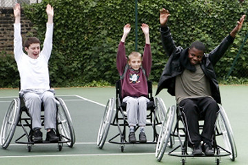 Youth playing game in wheelchair