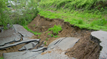 landslide slumping onto a road