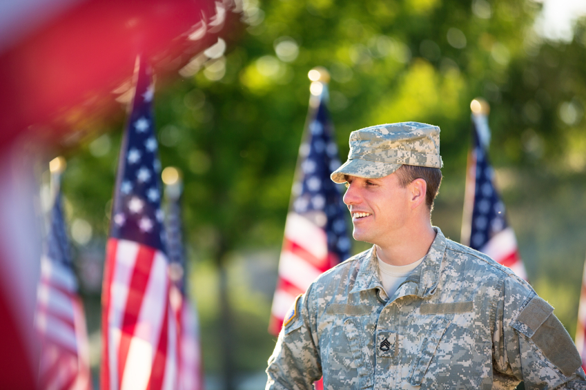 Male veteran standing among flags