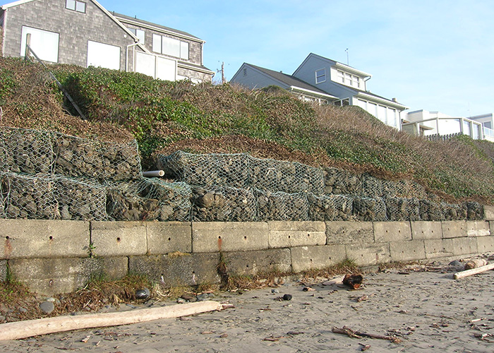 A sea-wall protects homes from sand and water