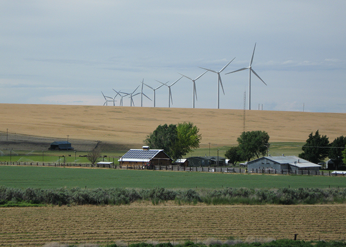 View of wind turbines overlooking a farm