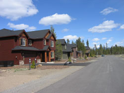 Newer 2-story homes with frontage on paved, rural road.