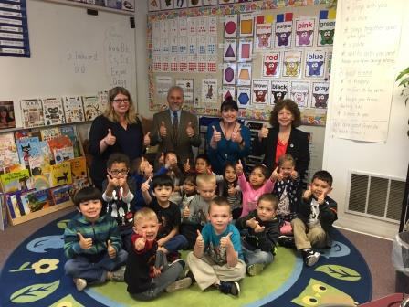 Deputy Superintendent Salam Noor with a classroom of first graders