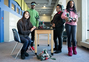 Students showing off their robotics class projects