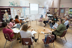 A picture of teachers in a meeting assessing student data