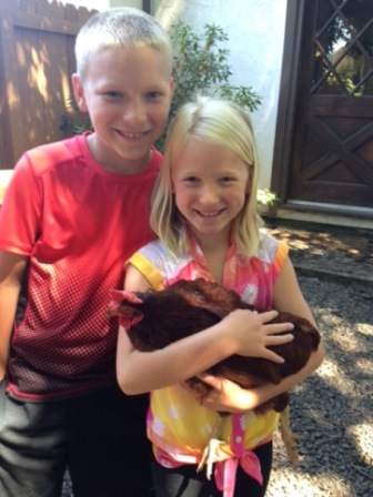 boy and girl holding a chicken