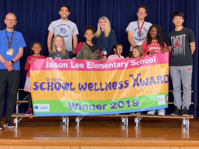 Jason Lee Elementary with School Wellness Award Banner