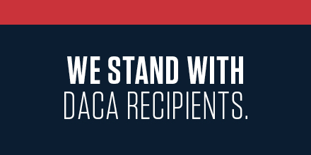 We Stand With DACA Recipients in white text, Navy blue background with red line on top.