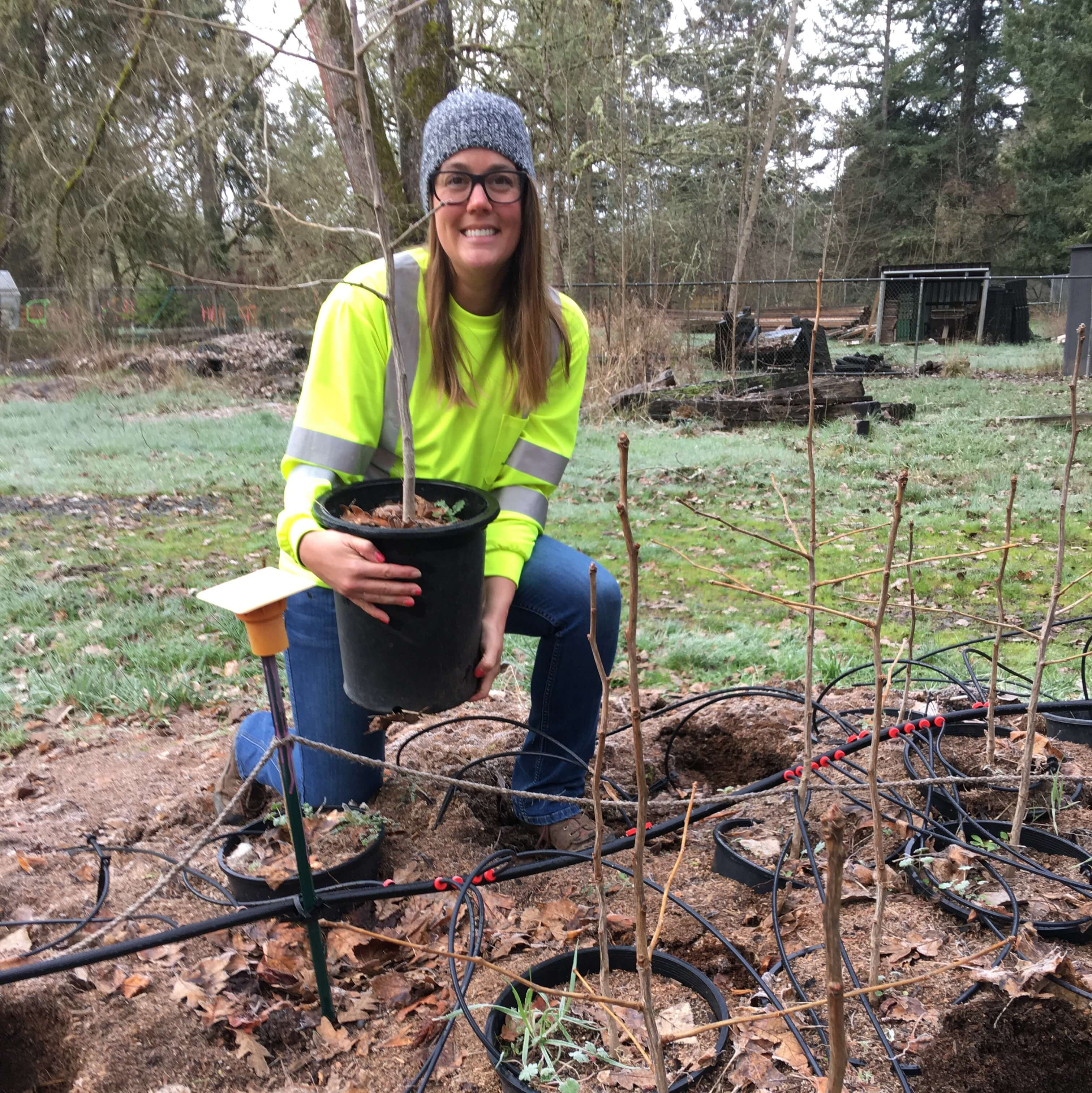 Jennifer Killian with a ginkgo seedling.