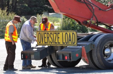 ODOT employees inspecting an oversize load truck
