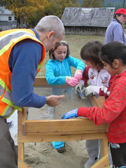 ODOT staff show students how to search for artifacts