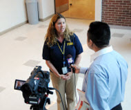 Local health official being interviewed by TV reporter