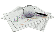 Charts and graphs with a magnifying glass