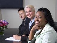 Smiling people sitting at a conference table