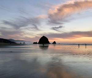 View of Haystack Rock from Cannon Beach ocean shore