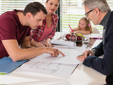 family discusses blueprints with engineer