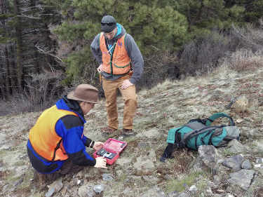 Image of geologists taking samples