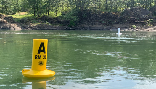 Buoy markers on the Willamette River to mark different zones of towed watersport operation