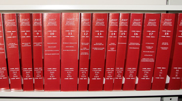 Image of Oregon revised statute books on a book shelf