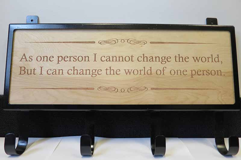 "sign that says ""As one person I cannot change the world, but I can change the world of one person."""