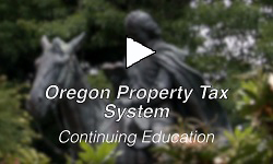 "Statue of man on horseback in background with words ""Oregon Property Tax System"" over top."